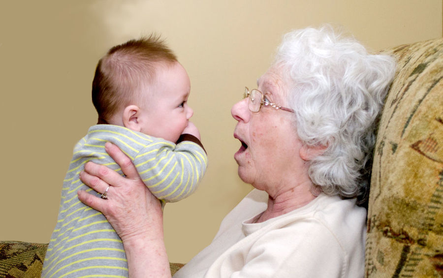 Grandma makes funny faces at a baby boy to get him to smile Females Low Angle View Adult Baby Backgrounds Bonding Child Childhood Emotion Family Funny Faces Grandma Headshot Infant Innocence People Portrait Positive Emotion Senior Adult Side View Togetherness Two People White Hair Women Young The Portraitist - 2018 EyeEm Awards