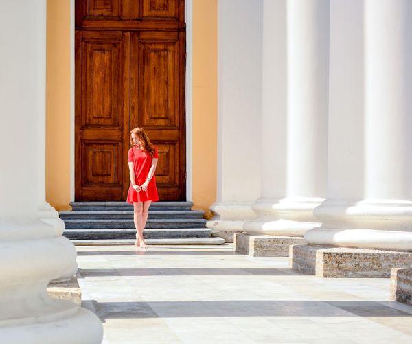 Full length of woman standing against entrance