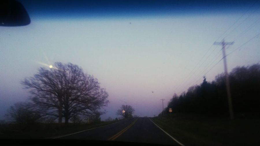 Clear Skies for A full moon Tree Astronomy Road Fog Sky Windshield Empty Road Diminishing Perspective The Way Forward Bare Tree Pathway Double Yellow Line vanishing point Country Road