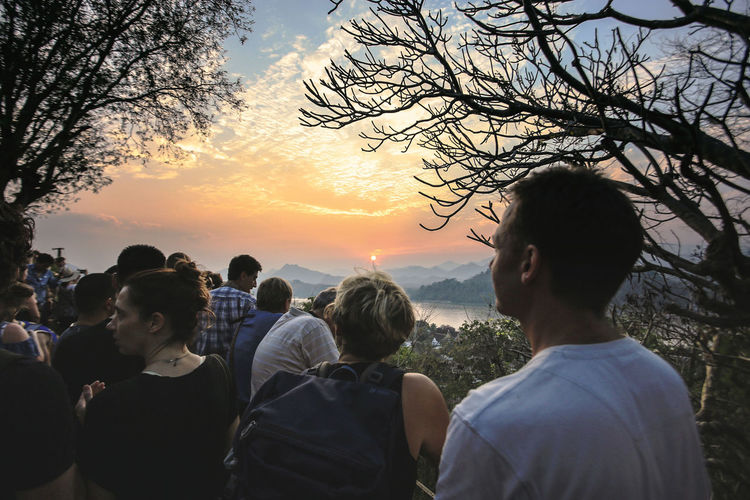 sunset at laungprabang, loas Adult Beauty In Nature Cloud - Sky Group Of People Lifestyles Men Nature Outdoors People Plant Sky Sunset Togetherness Tree