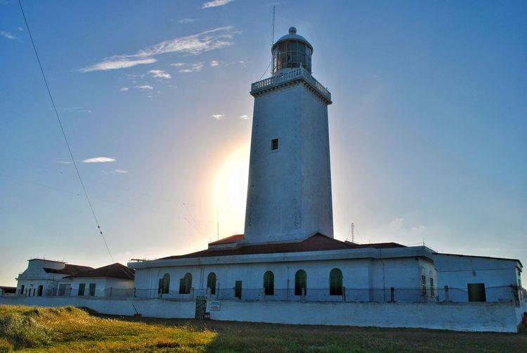 #faroldesantamarta #laguna Lighthouse Illuminated Sunset History Architecture Building Exterior Grass Tower First Eyeem Photo EyeEmNewHere