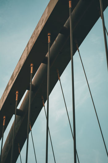 Low angle view of a cable stayed bridge against sky.