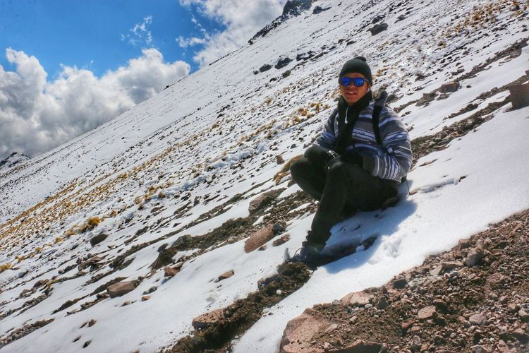 Portrait of woman sitting on snow covered mountain at la malinche national park