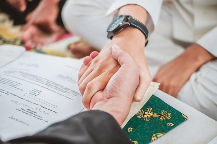 High angle view of people doing handshake