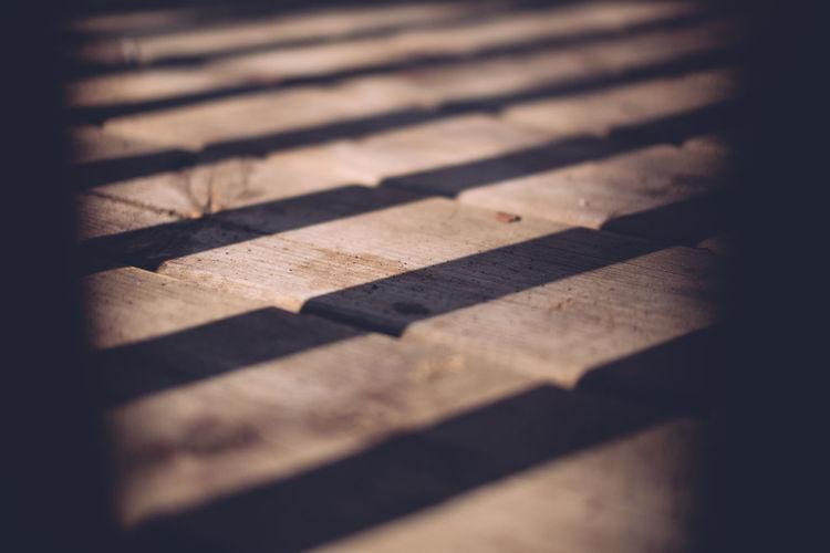 Full frame shot of shadows on wood