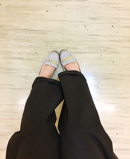 Person Personal Perspective Lifestyles Shoe Human Foot Black Pants Casual Shoes Waiting People Waiting Indoors  Waiting Room Seated Lady Boardwalk Floorboard Day Domestic Life