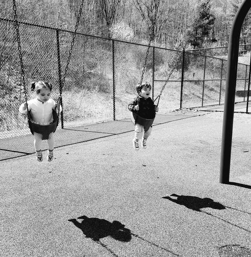 Swinging Childhood Outdoors Playground Togetherness
