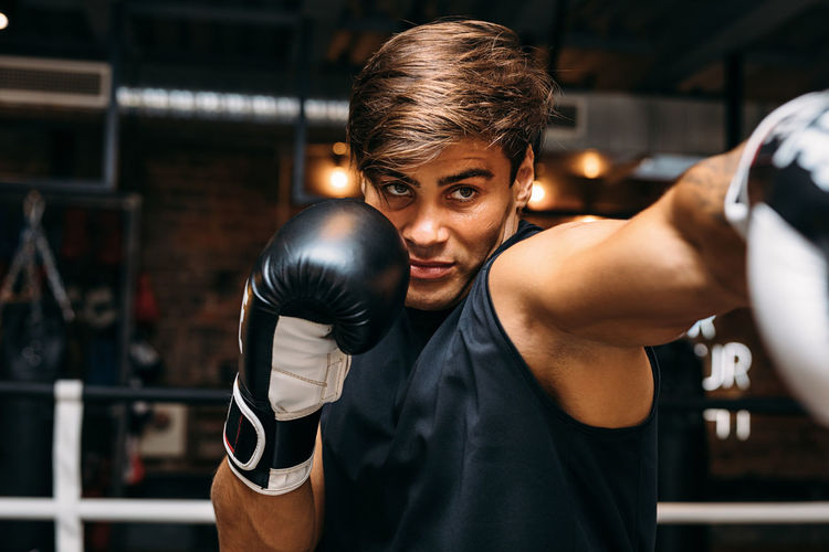 One Person Indoors  Lifestyles Sport Gloves Boxing Real People Indoors  Gym Caucasian Training Working Out Athlete Punch Boxer Boxing Ring Standing Sportsman Exercising Young