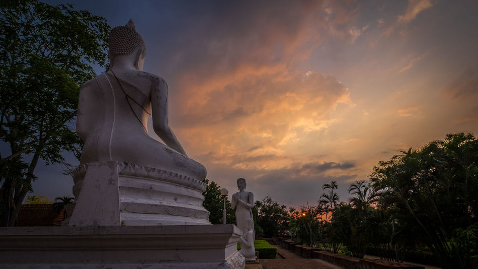 Art And Craft Ayutthaya | Thailand Cloud - Sky Colorful Sky And Clouds Creativity Golden Hour Low Angle View Nature Outdoors Sculpture Sky Statue Sunset Temple