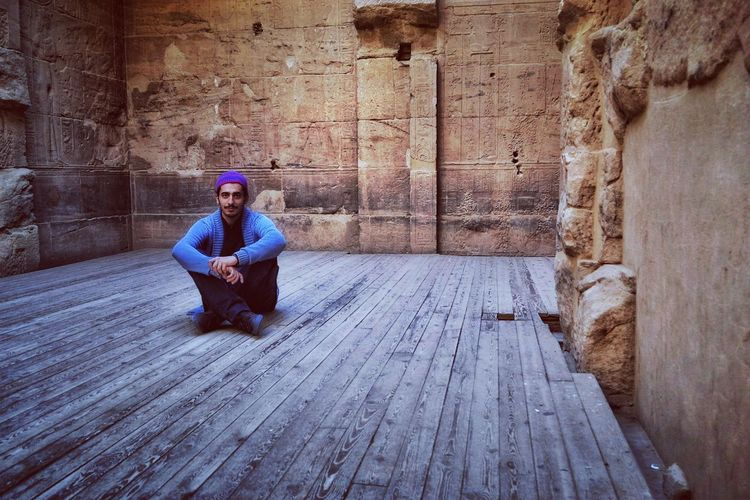 Everydayegypt Freshness Ancient Civilization Pharaoh - Ancient Egypt Temple Architecture Myegypt Sitting Full Length One Person Real People Adult Day Architecture Outdoors Young Adult Portrait
