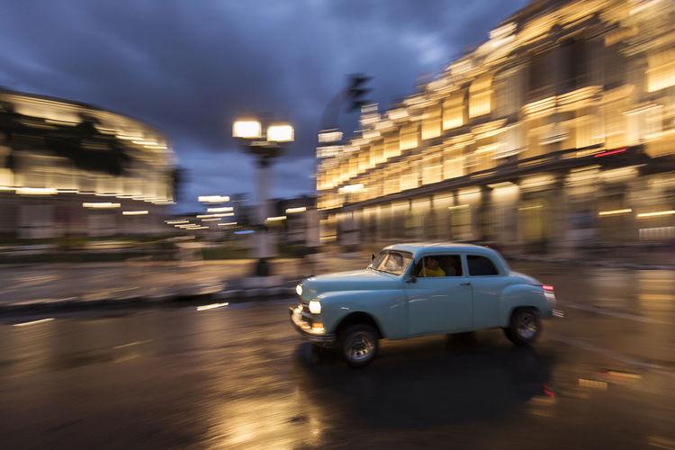 Car on city street at night