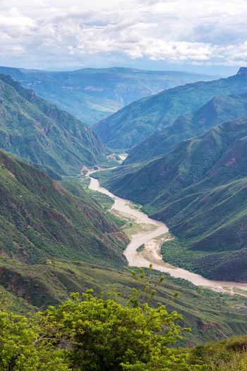 Vertical view of Chicamocha Canyon and river near Bucaramanga, Colombia Beauty In Nature Bucaramanga Canyon Chicamocha Chicamocha Canyon Cloud Colombia Green Color Landmark Landscape Mountain Mountain Range National Park Nature Outdoors Panachi Park River Santander Scenics Tranquility Tree Tree Trees Water