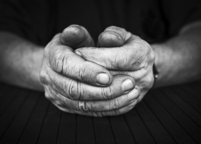 Cropped Image Of Man With Hands Clasped