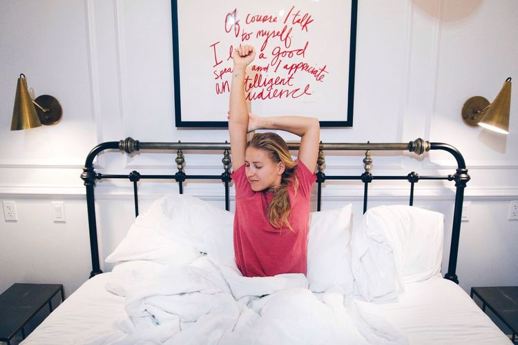 Stretching in bed after waking up Morning Rituals Stretching Out Stretching In Bed Waking Up Bed Bedroom Indoors  Pillow One Person Young Adult Real People Young Women