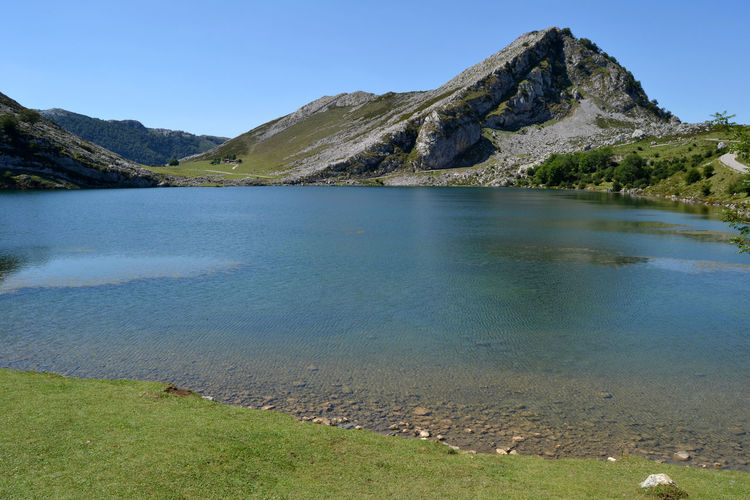 View of Lake Enol at Lakes of Covadonga in Asturias, Spain Asturias Blue Clear Sky Countryside Covadonga Enol Lake Green Lago Enol Lagos De Covadonga Lake Lake View Lakes  Landscape Mountain Nature Outdoors Park Peak Picos De Europa Picturesque Rural Scenics SPAIN Travel Water