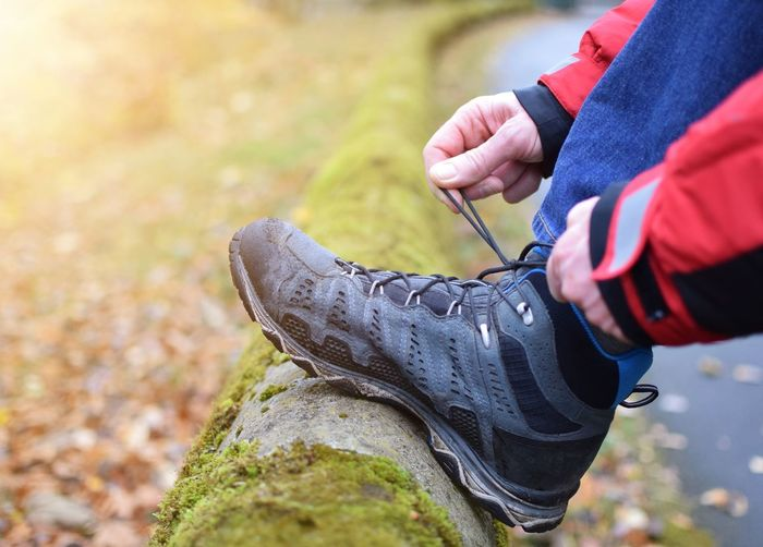 Lanyard Sneakers Object Sport Close Up Outdoors Lifestyles Background People person Looking Sneakers Light Human Hand Low Section Autumn Healthy Lifestyle Exercising Shoe Close-up Canvas Shoe Human Feet Human Foot Pair Footwear Hiker Jogging Human Leg Sports Shoe Shoelace
