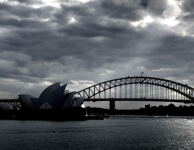 A ray of Light shining through Sea Sydney, Australia Ray Of Light Sunlight Cloudy Sky Sydney Harbour Bridge Sydney Opera House Cloud - Sky Sky Architecture Built Structure Water Transportation Bridge Travel Destinations No People Outdoors Tourism Bridge - Man Made Structure Waterfront The Architect - 2018 EyeEm Awards The Traveler - 2018 EyeEm Awards The Traveler - 2018 EyeEm Awards