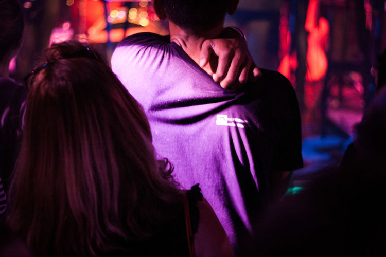 Midsection of woman dancing at nightclub