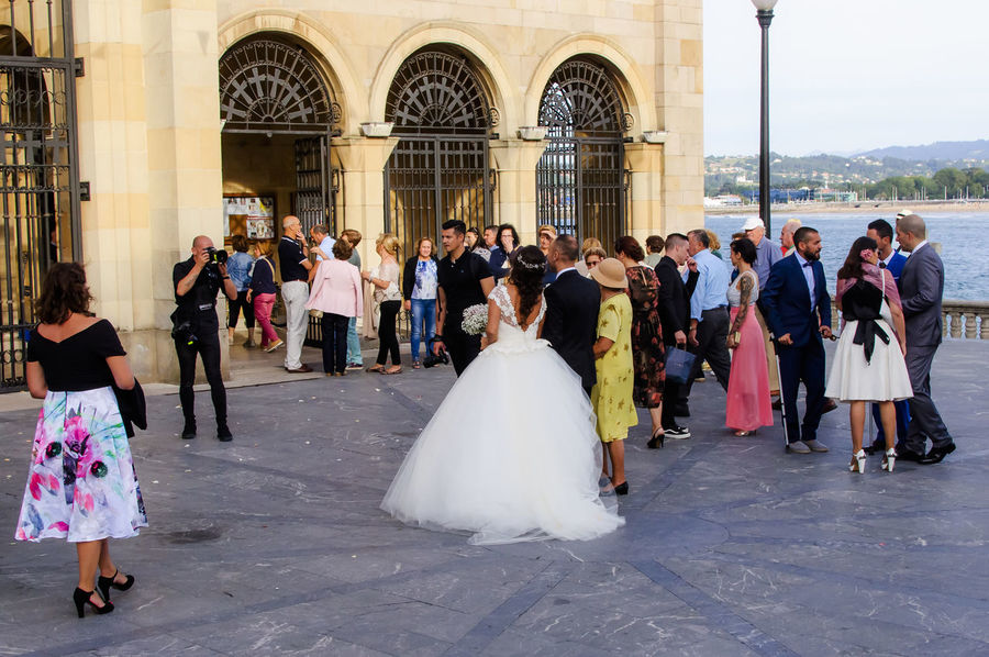 Bride and wedding party outside the church in Gijon Asturias, Spain. City City Life Couple Taking Photos Wedding Architecture Bride Bridegroom Built Structure Celebration Day Group Guests Large Group Of People Life Events Men Outdoors People Real People Togetherness Wedding Day Wedding Dress Women