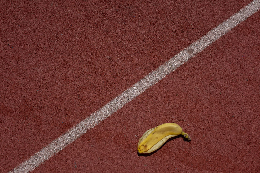 Tennis / Banana. Sport Peel Diagonal Stripe Banana Discarded France LINE Red Tennis Abstract Banana Banana Peel Chalk Chamonix Food Fruit No People Outdoors Peel Red Running Track Sport Tenniscourt Track And Field Yellow