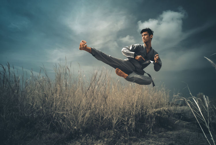 Kungfu... (Infrared 720nm) Art Is Everywhere Infrared Day Energetic Field Full Length Grass Infrared Photography Jumping Kungfu  Low Angle View One Person Outdoors Sky Young Men EyeEmNewHere The Week On EyeEm Rethink Things