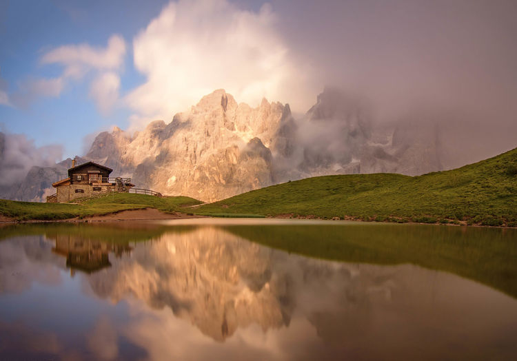 || Light in shadow || Reflection Water Fog Lake Mountain Landscape Sunset Scenics Outdoors Nature Dawn Beauty Beauty In Nature Sky Day Travel Destinations Mountain Range Light Mountain Peak Trentino Alto Adige Dolomites, Italy Passo Rolle Baita Segantini