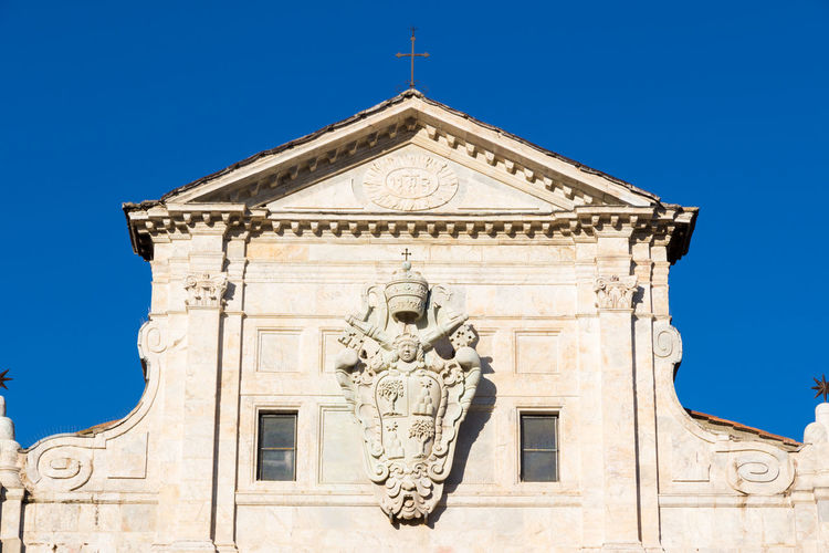 Architecture Art And Craft Bas Relief Belief Blue Building Building Exterior Built Structure Clear Sky History Human Representation Low Angle View Male Likeness Marsiglia Nature No People Ornate Outdoors Religion Representation Sculpture Sky Statue The Past