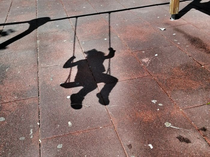 Shadow of swing on the ground