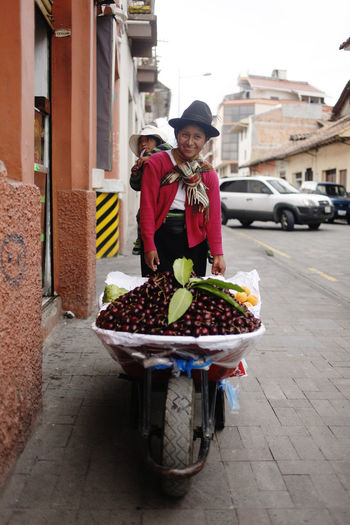Building Exterior Real People Built Structure Architecture Looking At Camera Transportation Food One Person Smiling Front View Standing Portrait Healthy Eating Mode Of Transportation Land Vehicle Food And Drink Fruit Day Casual Clothing Outdoors Cuenca Ecuador