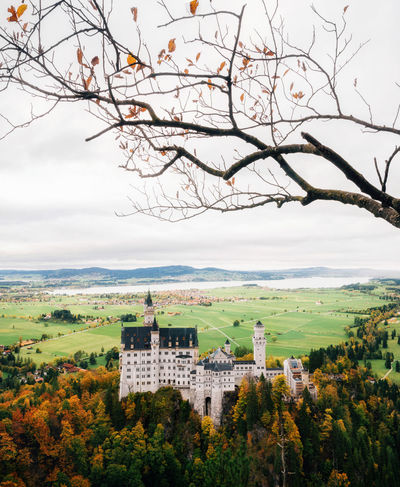 Neuschwanstein castle in colorful autumn day in Bavaria, Germany Bavaria Bavarian Landscape GERMANY🇩🇪DEUTSCHERLAND@ Neuschwanstein Architecture Bare Tree Branch Building Exterior Castle Germany Landscape Mountain Nature No People Outdoors Scenics Sky Travel Destinations Tree Go Higher