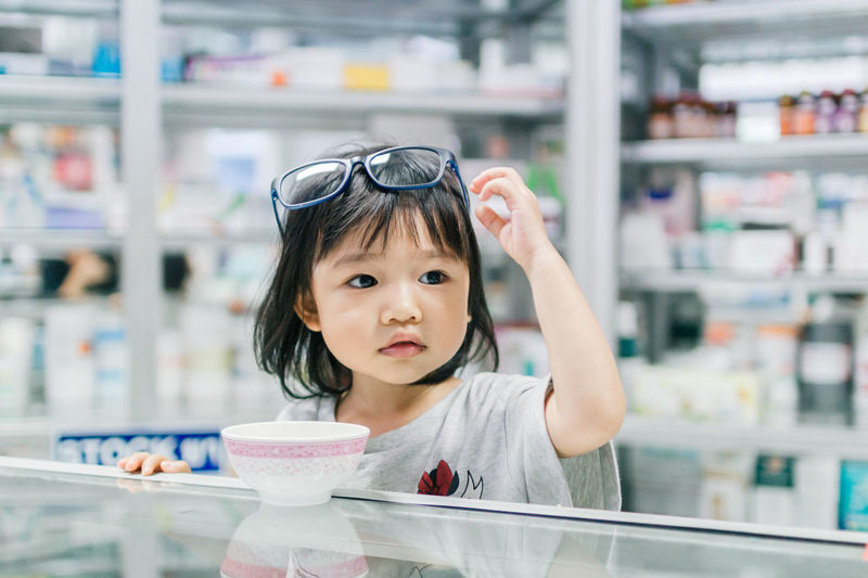 Asian Girl Child Childhood Children Only Close-up Day Focus On Foreground Front View Frozen Food Headshot Ice Cream Indoors  Looking At Camera One Person People Portrait Real People