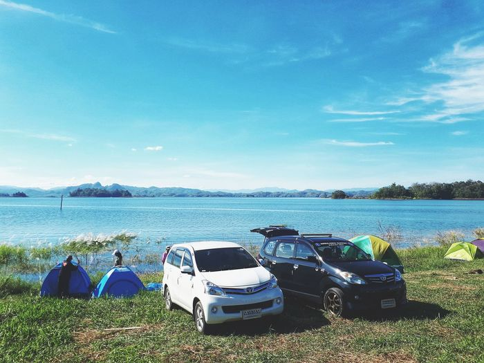 Camping holiday summer, outdoor, activity, leisure activity, sunlight, field, camping, summer, holiday, vacation, travel, traveling, tourist, relax, nature, adventure, moment, location, landscape, water, horizon Horizon Over Water Cloud - Sky Sky Nautical Vessel Beach Sea Water Landscape Vacation Location Toyota Tourist Tourism Traveling Travel Activity Adventure Car Fresh Bright Nature Holiday Summer Soft Light Colorful Blue Sky Blue Tent Camp Camping Mode Of Transportation Transportation Land Day Beauty In Nature Scenics - Nature Grass Land Vehicle Plant Sunlight Field Motor Vehicle Leisure Activity Outdoors
