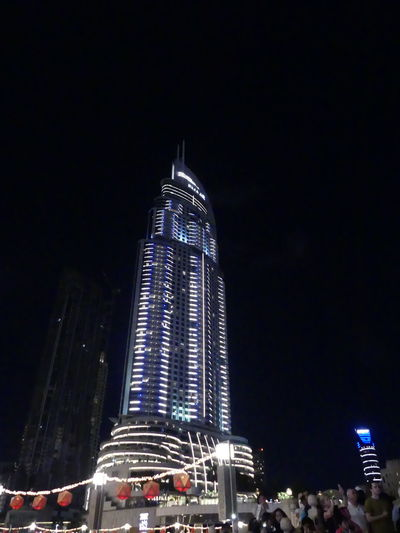 Emaar Tower at Night, Dubai, United Arab Emirates 2019 Dubai UAE 2019 Emaar Night Illuminated City Tall - High Skyscraper No People Tower Low Angle View Black Background Tower Block  Modern Architecture Modern Design Glass And Steel Structure Building Exterior Building Facade Outdoor Photography Night Photography Blue And White Light Tourist Destination Travel Famous Building