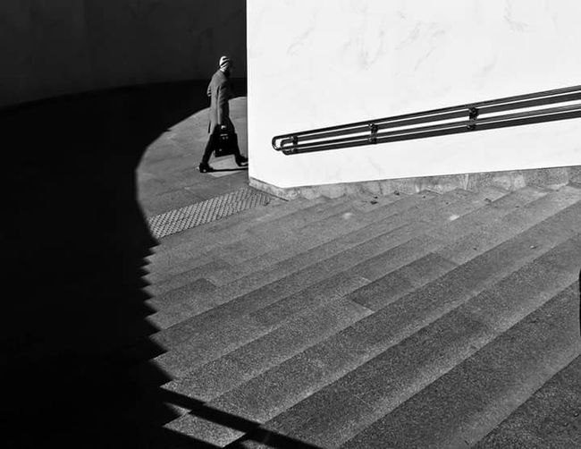 The Street Photographer - 2017 EyeEm Awards Blackandwhite Black & White Streetphotography Streetphoto_bw Street Shadow And Light Stairs Black And White Friday