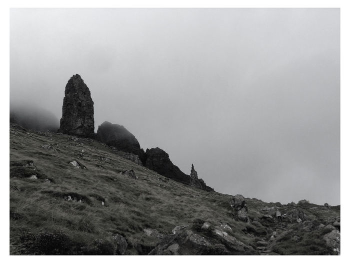Low angle view of rock formations on land against sky