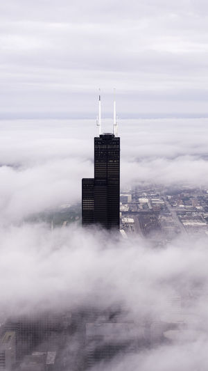 Low flying clouds Building Exterior Built Structure Architecture Sky Cloud - Sky Building City No People Nature Day Tower Outdoors Environment Office Building Exterior Fog Cityscape Tall - High Skyscraper Landscape