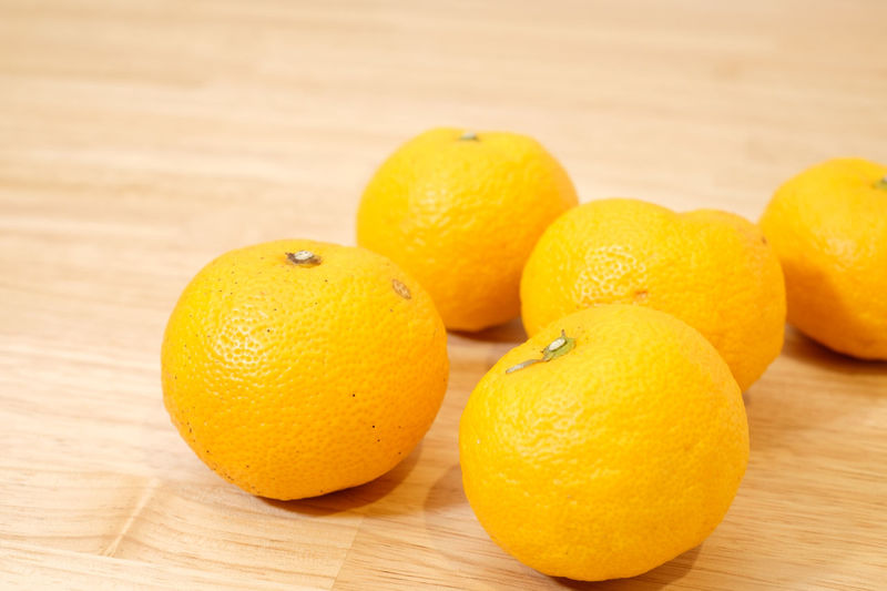 Citron, Japanese YUZU Fruit Citrus Fruit Healthy Eating Wellbeing Food Food And Drink Freshness Still Life Indoors  Close-up Orange Color Orange Orange - Fruit No People Yellow Citron Yuzu Table Wood - Material Focus On Foreground Group Of Objects Wood Grain