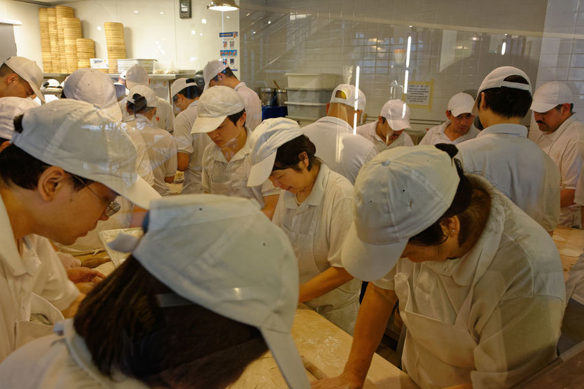 Chinese Food Taiwanese Food Adult Chef Chefs Commercial Kitchen Commercial Kitchens Day Din Tai Fung Dumpling Skin Dumplings Food Preparation Indoors  Kitchen Large Group Of People Men People Real People Standing Steamed Dumplings Teamwork Togetherness Uniform Women