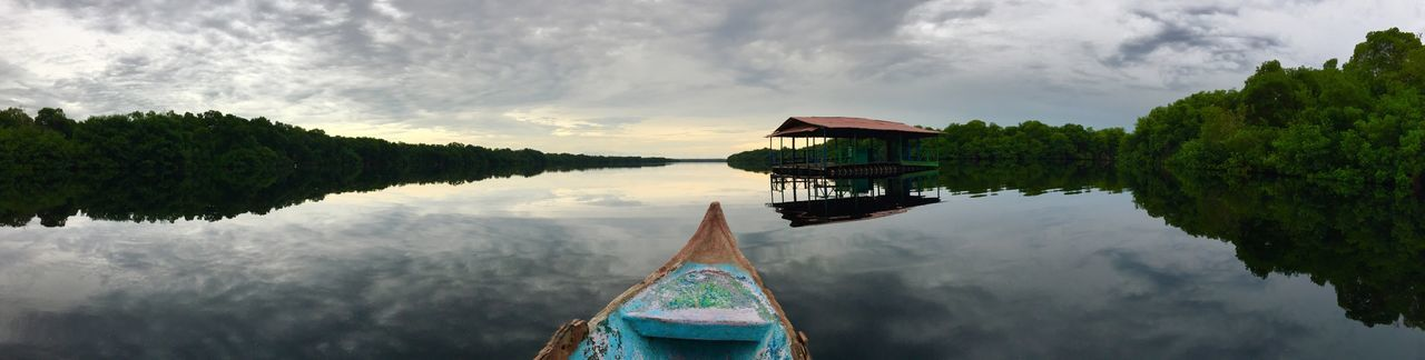 Water Sky Cloud - Sky Nature Tree Outdoors Nautical Vessel Reflection Tranquility Day Beauty In Nature Transportation Mode Of Transport Real People Scenics Lake One Person Architecture People Ciénaga Marsh Magical Realism Realismo Mágico Colombia