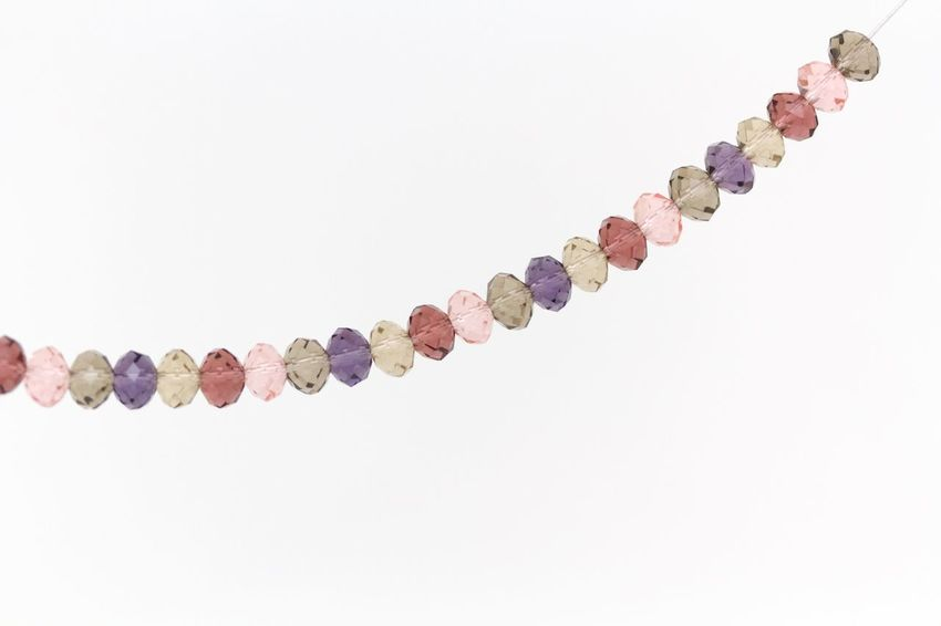wine, opal, purple and pink swarovski crystals necklace on white background Abundance Beaded Jewelry Close-up Crystals Finance Jewelry Large Group Of Objects Multi Colored No People Swarovski Variation White Background