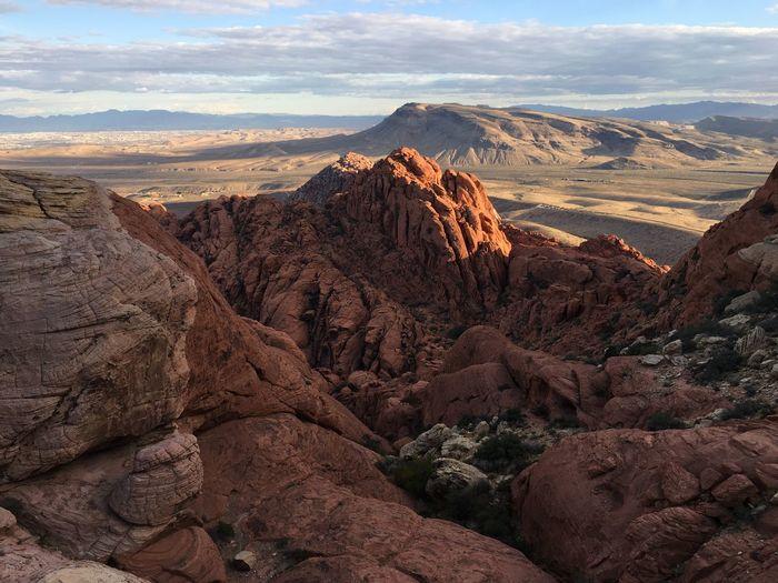 Rock formation on landscape against sky