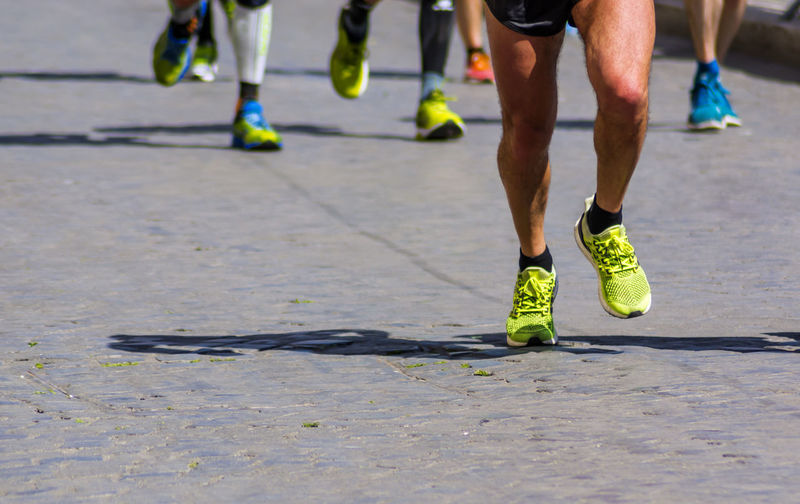 City Marathon running race. Shoes on cobblestone street Marathon Athlete Body Part Day Exercising Healthy Lifestyle Human Body Part Human Foot Human Leg Human Limb Leisure Activity Lifestyles Low Section Men Motion Nature Outdoors People Real People Runner Running Shoe Sport Sports Clothing Sports Shoe