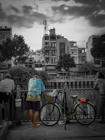 Bicycle Cycling Outdoors City Building Exterior Adult People Adults Only Sky Day Old Man Fishing Fisherman Fishing Time Black & White Streetphotography Street Photography Street Style Life Moments Capture The Moment CaptureTheMoment Relaxing Relaxing Moments Horizontal PhonePhotography