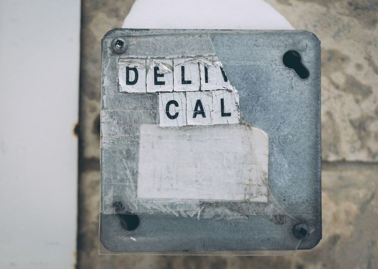 Call here Communication Close-up Text Western Script No People Day Number Sign Old Outdoors Script Single Object Information Information Sign Wall - Building Feature Metal Power Supply