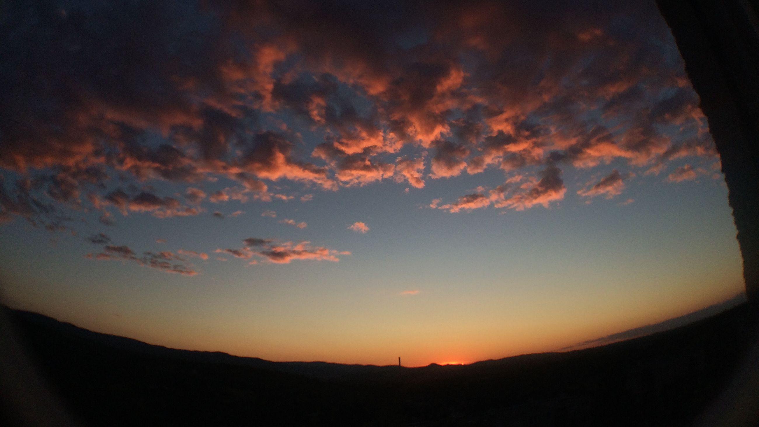 sunset, sky, scenics, silhouette, tranquil scene, beauty in nature, tranquility, cloud - sky, orange color, nature, idyllic, cloud, landscape, mountain, dramatic sky, majestic, dark, cloudy, dusk, cloudscape