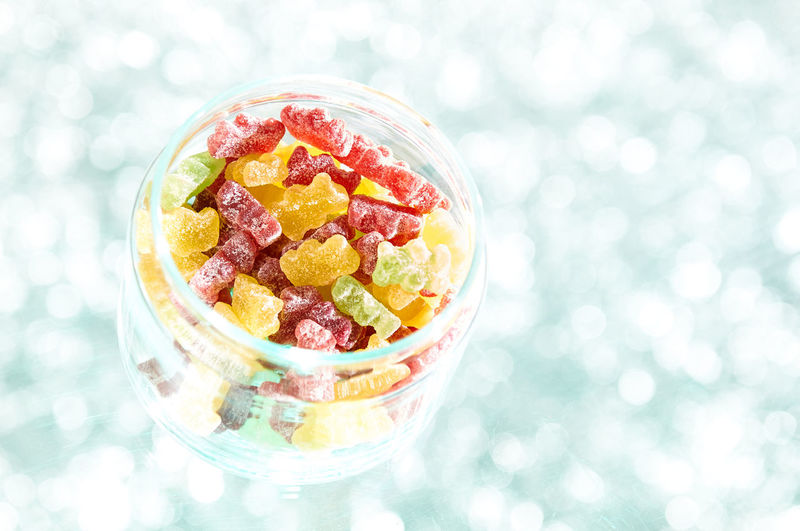 High angle view of fruits in glass bowl on table