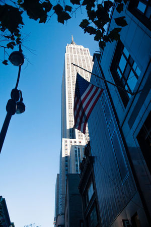 2008 Architecture Building Building Exterior City City Life Clear Sky Development Exterior Flag Low Angle View Modern Office Building Outdoors Patriotism Skyscraper Street Light Tall Tall - High Urban