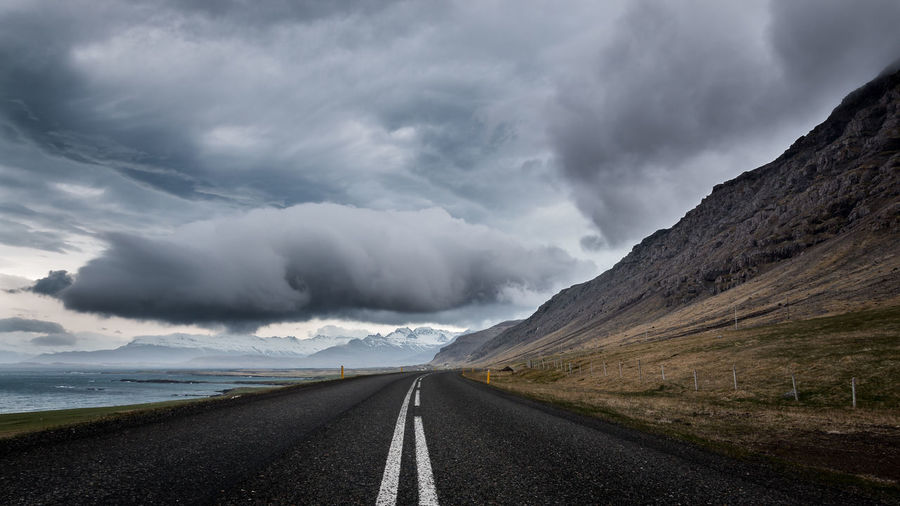 Iceland Beauty In Nature Cloud - Sky Day Landscape Mountain Nature No People Outdoors Road Scenics Sky The Way Forward
