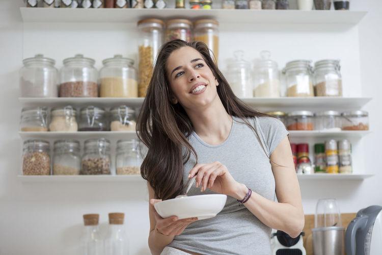 Close-up of woman having food at table