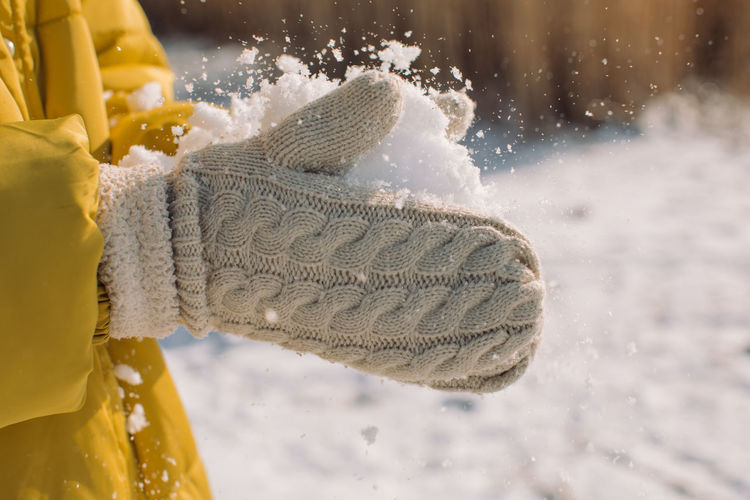 Close-up of snow on person during winter
